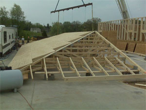 Trusses and engineered building materials from ghk truss for Barrel roof trusses